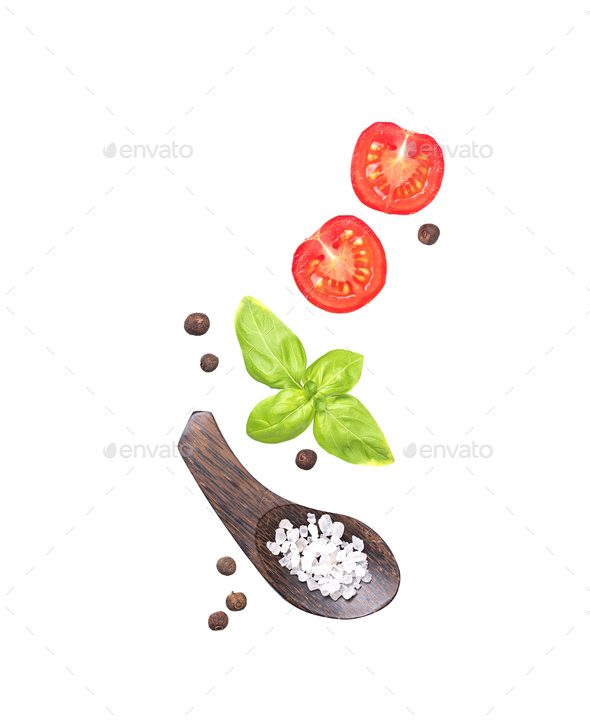 Cherry tomatoes, basil, salt and pepper isolated on white - Stock Photo - Images