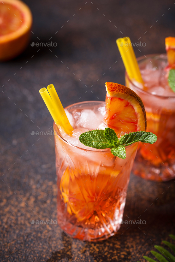 Negroni cocktail with orange and ice - Stock Photo - Images