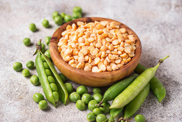 Fresh and dry peas on light background - Stock Photo - Images