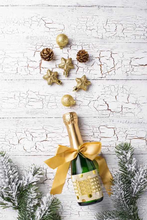 Bottle of champagne in a gold wrapper - Stock Photo - Images
