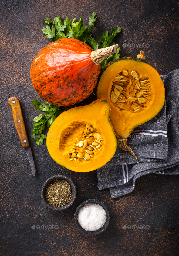 Halves of hokkaido pumpkin with spices - Stock Photo - Images
