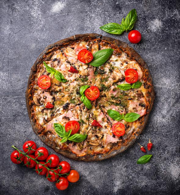 Italian pizza on black dough. Trendy food - Stock Photo - Images