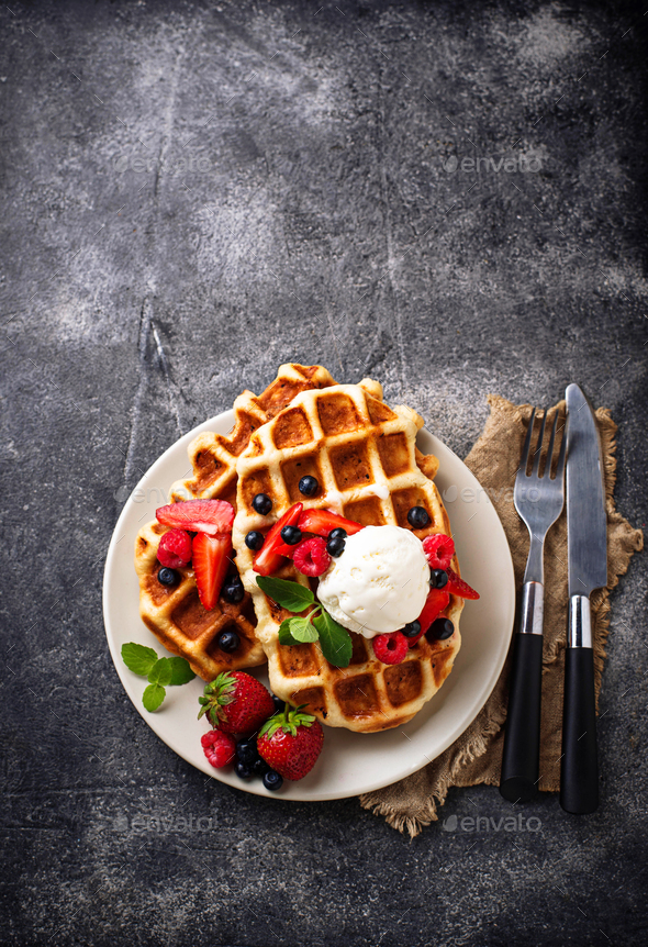 Belgium waffles with berries and ice cream - Stock Photo - Images