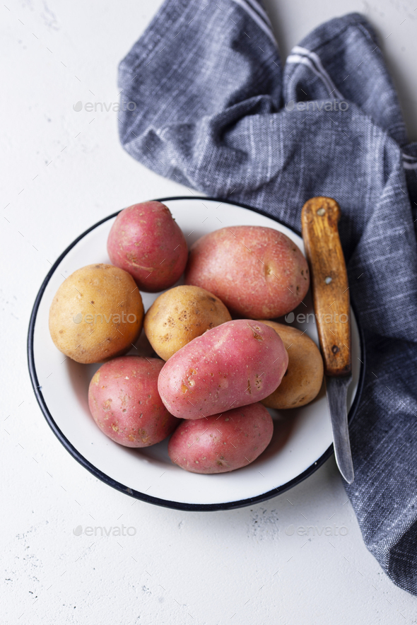 Various sorts of raw organic potatoes - Stock Photo - Images