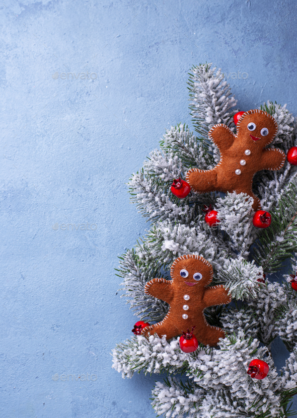 Christmas gingerbread men made of felt - Stock Photo - Images