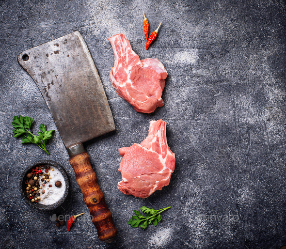 Raw meat and butchers knife - Stock Photo - Images