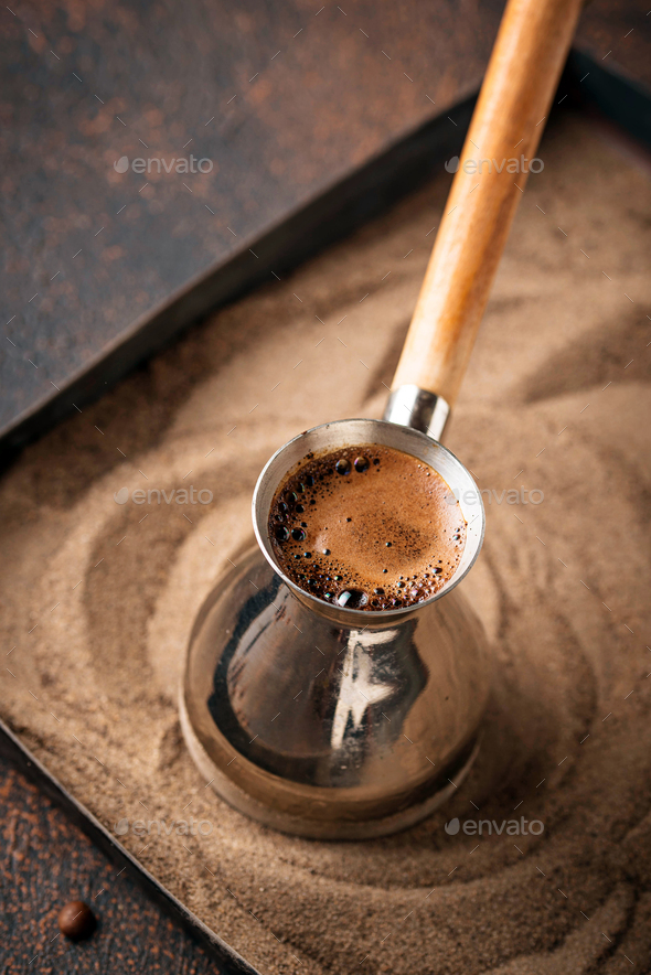 Traditional turkish coffee in cezve - Stock Photo - Images
