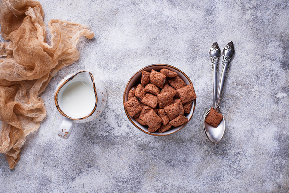 Cocoa puffs corn flakes on light background - Stock Photo - Images