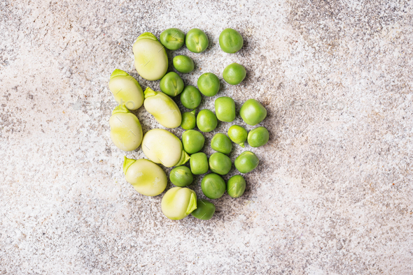 Fresh green peas and beans on light background - Stock Photo - Images