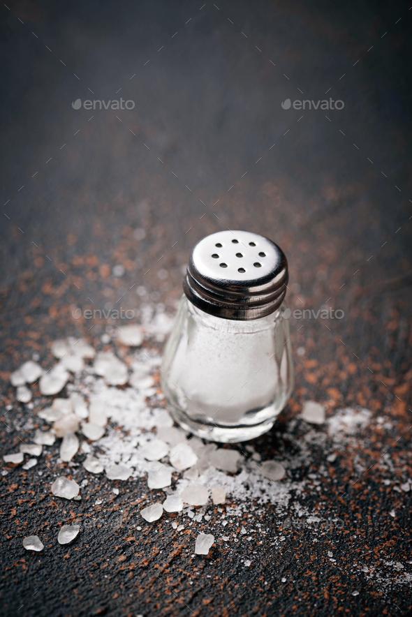 White sea salt on rusty background - Stock Photo - Images