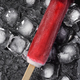 Red ice cream popsicle on black background with ice - PhotoDune Item for Sale