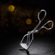 Metal eyelash curler on black background with copy space - PhotoDune Item for Sale