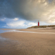 stormy sky over North sea beach with red lighthouse - PhotoDune Item for Sale