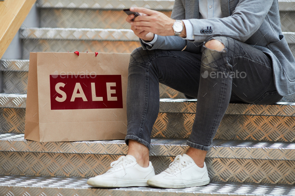Man using Mobile App while Shopping - Stock Photo - Images