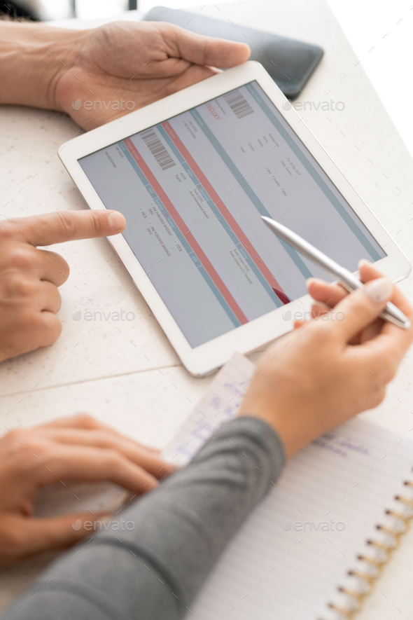 Hands of young contemporary colleagues discussing online financial information - Stock Photo - Images