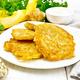 Pancakes of pumpkin with Jerusalem artichoke in plate on white board - PhotoDune Item for Sale