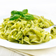 Pasta with pesto sauce in plate on white board - PhotoDune Item for Sale