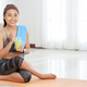 Smiling sportswoman with glass of smoothie - PhotoDune Item for Sale