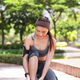 Asian sportswoman tying shoelace on walkway - PhotoDune Item for Sale