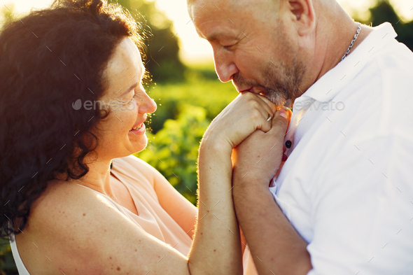 Beautiful adult couple spend time in a summer field - Stock Photo - Images