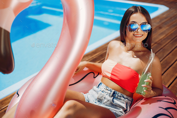 Girl on summer party in the swimming pool - Stock Photo - Images
