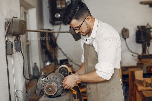 Handsome carpenter working with a wood - Stock Photo - Images