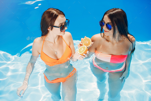 Girls on summer party in the swimming pool - Stock Photo - Images