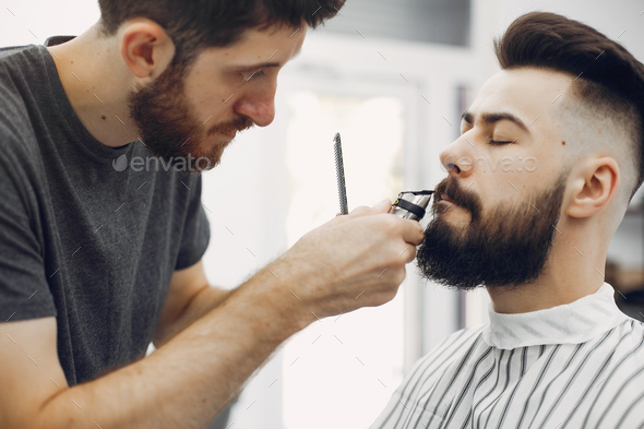 Stylish man sitting in a barbershop - Stock Photo - Images