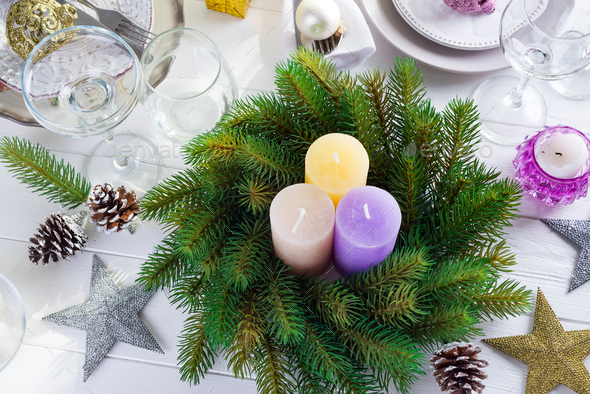 Place table setting for Christmas white table with purple decor elements and green wreath Christmas - Stock Photo - Images