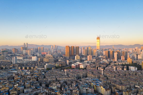 kunming cityscape in early morning - Stock Photo - Images