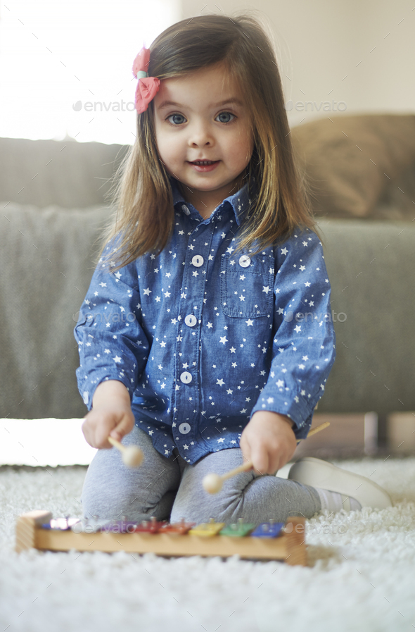 Probably she will be musician in the future - Stock Photo - Images