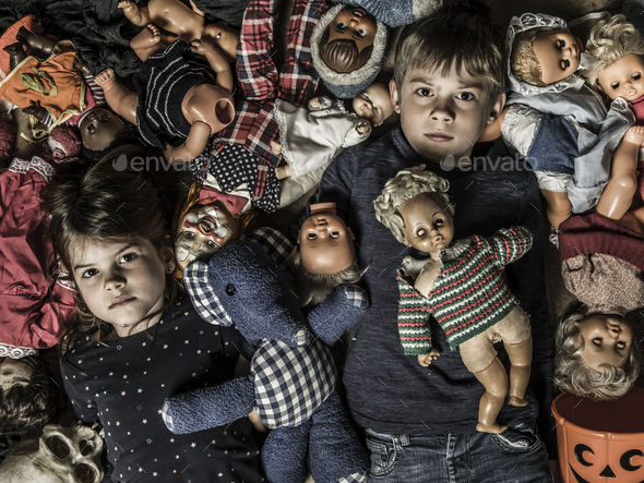 Creepy children with scary dolls - Stock Photo - Images