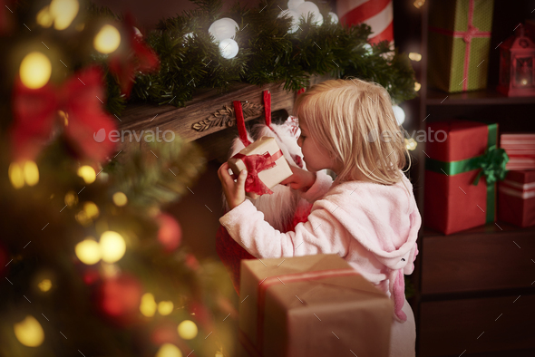 Finally she can unpack her presents - Stock Photo - Images