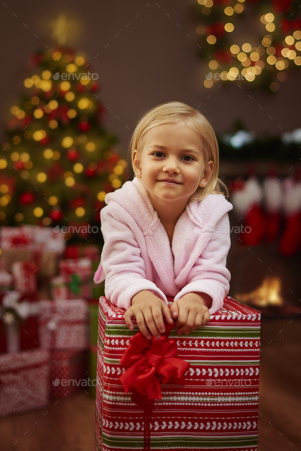 She can't wait to unwrap all of presents - Stock Photo - Images