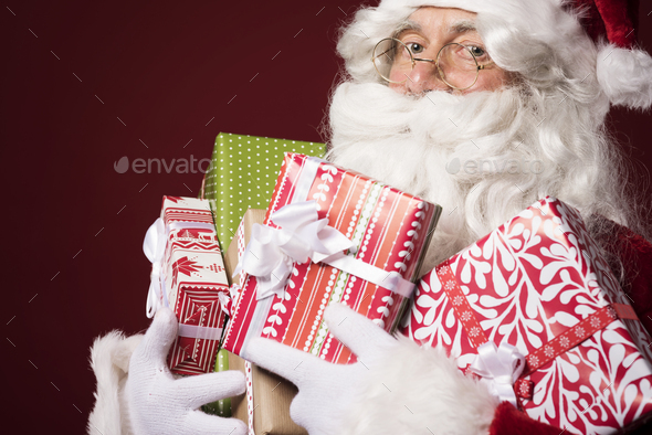 Santa will need another sack for these gifts - Stock Photo - Images