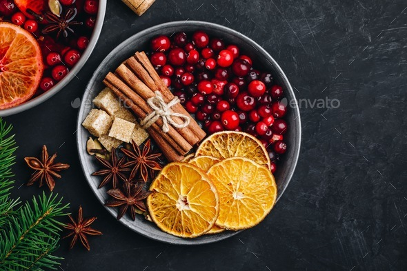 Mulled Wine Ingredients with cranberries, oranges, cinnamon - Stock Photo - Images