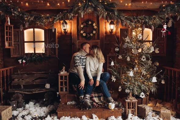 Christmas portrait of a romantic couple. beautiful house - Stock Photo - Images