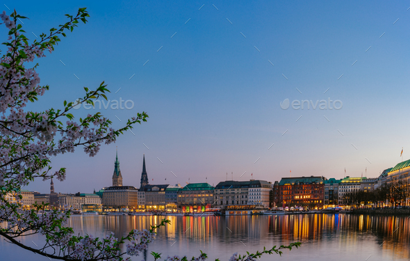 Beautiful panoramic view of calm Alster river with Hamburg town hall - Rathaus behind the buildings - Stock Photo - Images