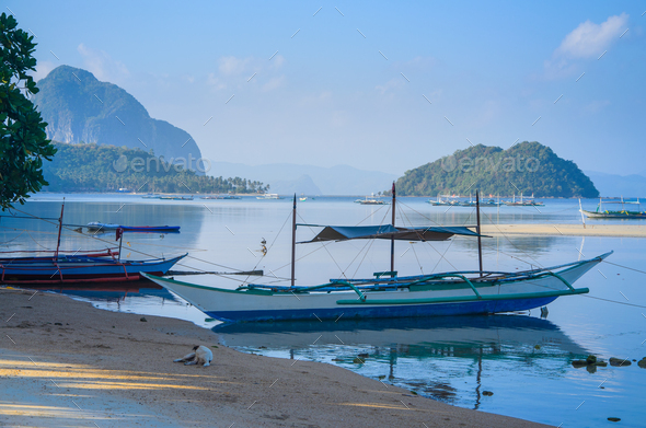Traditional banca boat at sandy Corong Beach in El Nido, Philippines - Stock Photo - Images