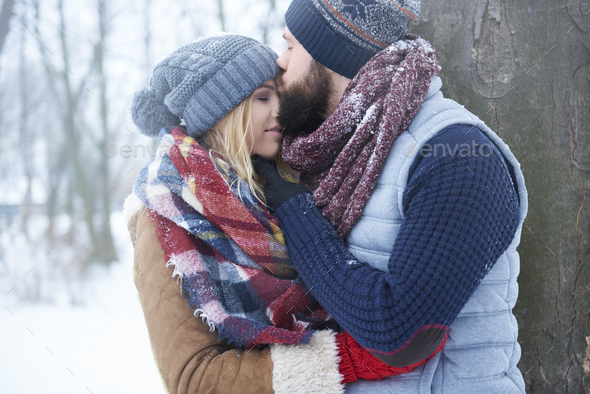 Sweet kiss in winter day - Stock Photo - Images