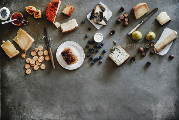 Variety of wine snacks and cheeses over grey background - Stock Photo - Images