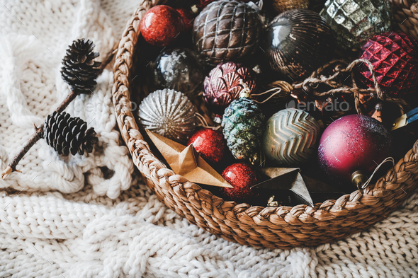 Christmas glass decoration toys and balls in basket - Stock Photo - Images