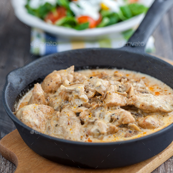 Chicken in cream sauce with mushrooms - Stock Photo - Images