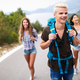 Group of friends backpackers walking and traveling outdoor - PhotoDune Item for Sale