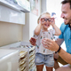 Health care, eyesight and vision concept. Little girl choosing glasses with father at optics store - PhotoDune Item for Sale
