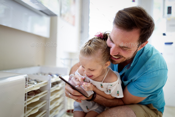Happy joyful young father with his little daughter. Father and little kid having fun - Stock Photo - Images