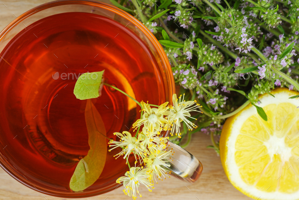 Cup of herbal tea with lemon and thyme - Stock Photo - Images