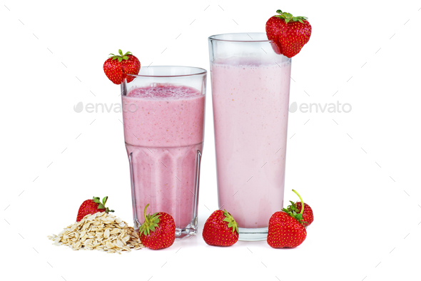 Two glasses of pink strawberry smoothie with oat flats - Stock Photo - Images
