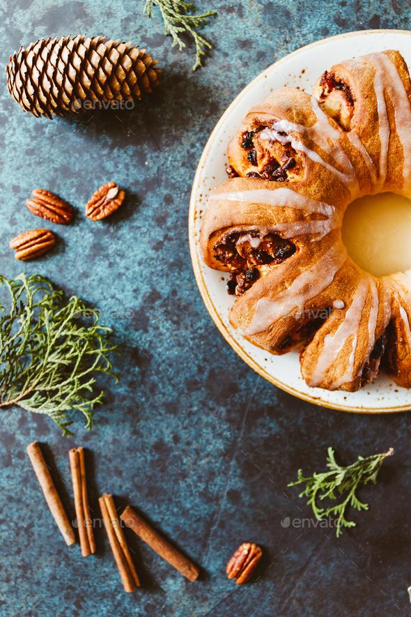 Creative flat lay, top view of Swedish tea ring Christmas cake - Stock Photo - Images