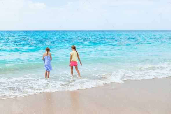 Kids have a lot of fun at tropical beach playing together - Stock Photo - Images